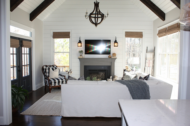 Great room with floor to ceiling shiplap vaulted ceiling and dark stained beams