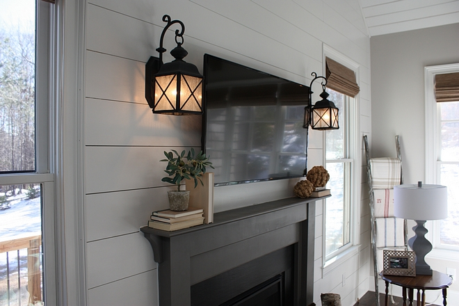 Fireplace sconces Sconces flanking fireplace against shiplap paneling Fireplace sconces