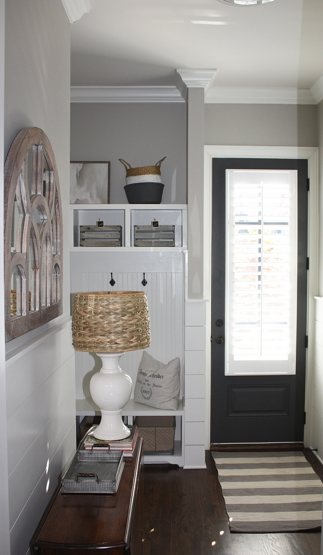 Mudroom with half wall shiplap and grey walls