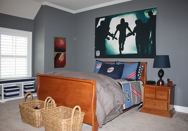 This is one of the boys' rooms Storage baskets at the end of the bed, as well as in the window built-ins makes keeping his room picked up a little easier