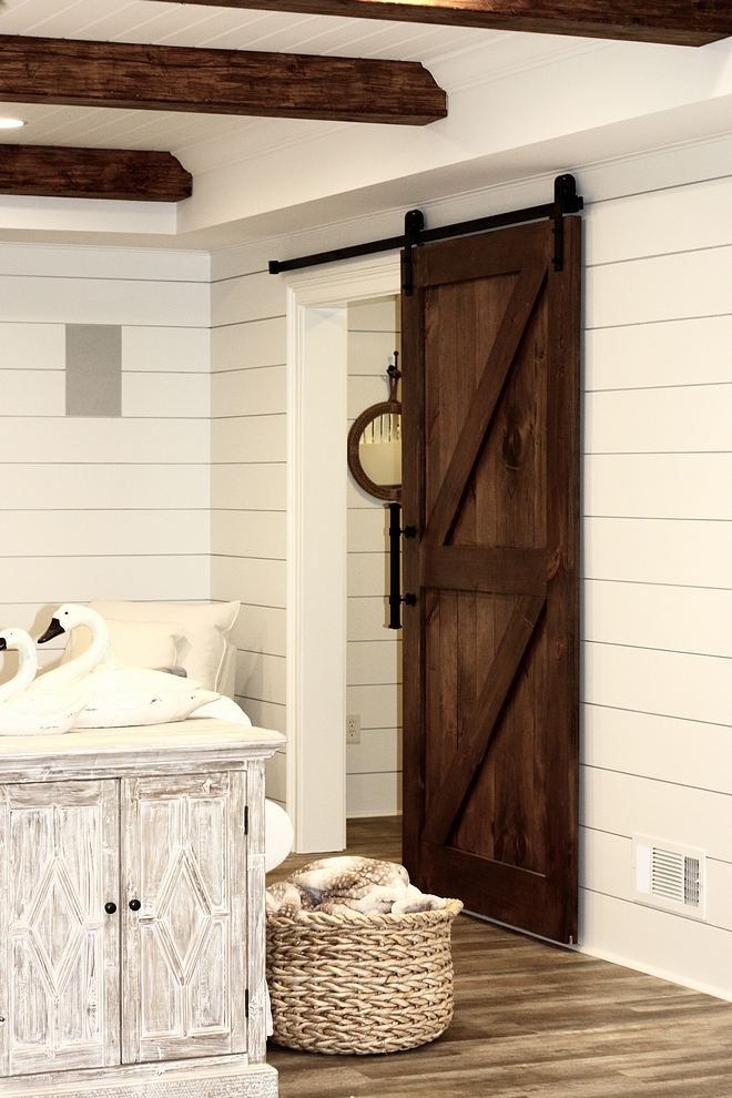 Custom-made barn door that opens and closes to the bunk room Shiplap and custom barn door