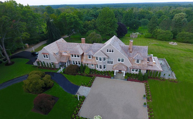 Residencial drone photography Perfectly sited, with majestic views, this shingle-style home is naturally elegant and grand-in-style