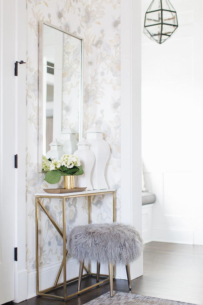 Foyer Decor Neutral Foyer Decor Ideas Brass console table and Grey Mongolian Lamb Stool Foyer Decor