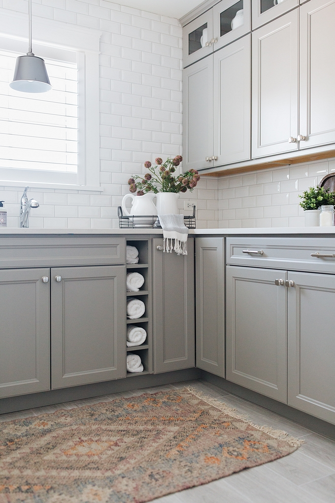 Laundry room Backsplash is beveled subway tile