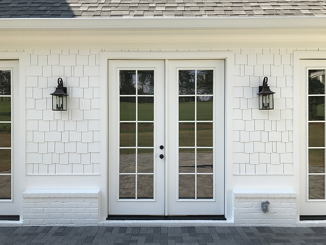 Outdoor Sconce Lighting, white single siding and painted white brick source on Home Bunch