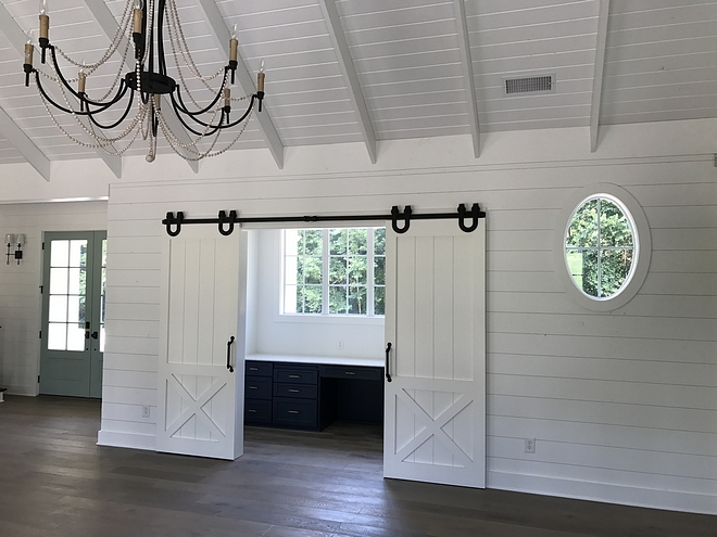Half X Brace Barn Door Home Office Barn Door Shiplap walls shiplap ceiling hardwood floors home office off family room with Half X Brace Barn Doors