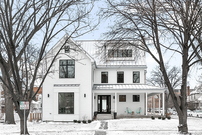 White farmhouse with black windows metal roof and black steel front door exterior modern farmhouse architecture
