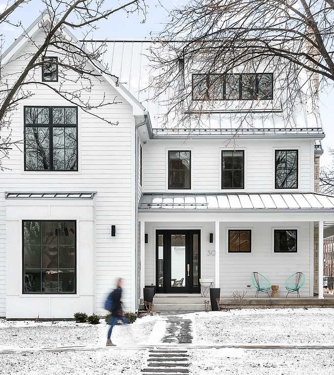 White Modern Farmhouse This white modern farmhouse also features black Pella windows and doors