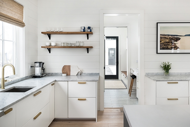 Modern farmhouse kitchens Perimeter countertop is Carrera marble Backplash is shiplap painted in Benjamin Moore Simply White