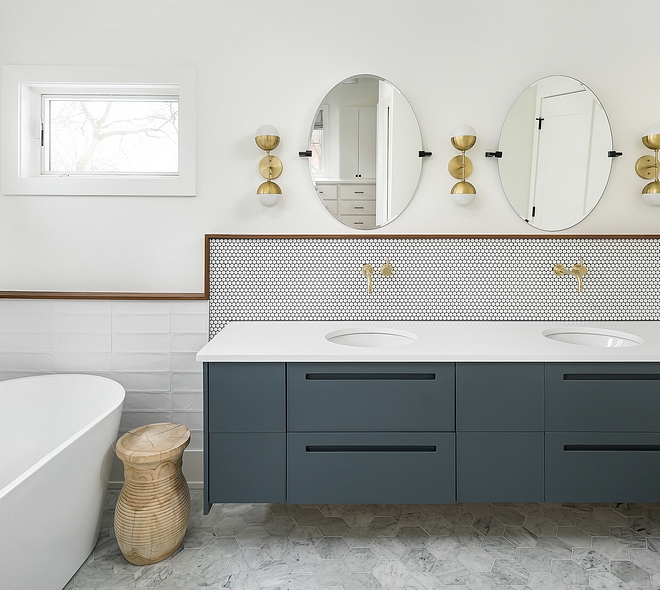 Floating vanity The master bathroom features a double floating vanity Countertop is white quartz