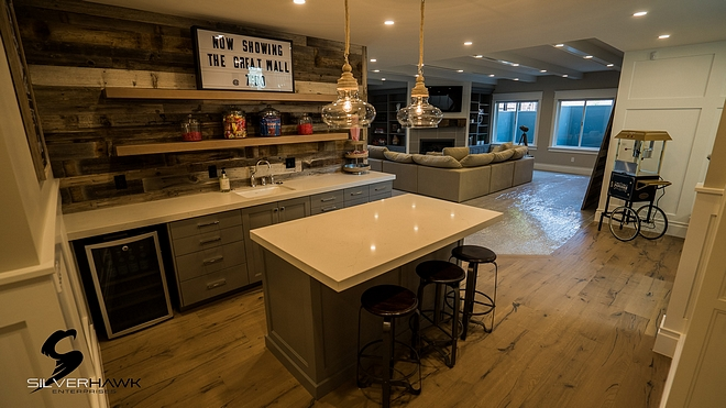 Farmhouse Basement Bar with reclaimed shiplap and white quartz countertop