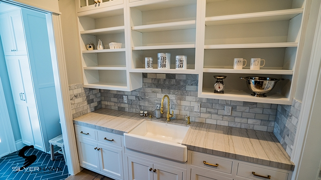 Butlers pantry with white quartzite countertop and marble subway tile sources on Home Bunch