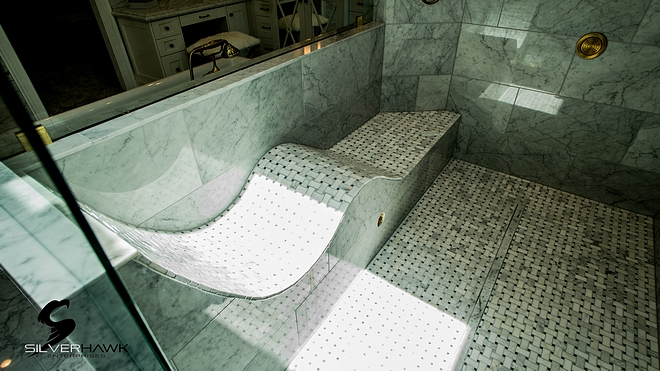 Shower Bench features Bianca Carrara basketweave pattern