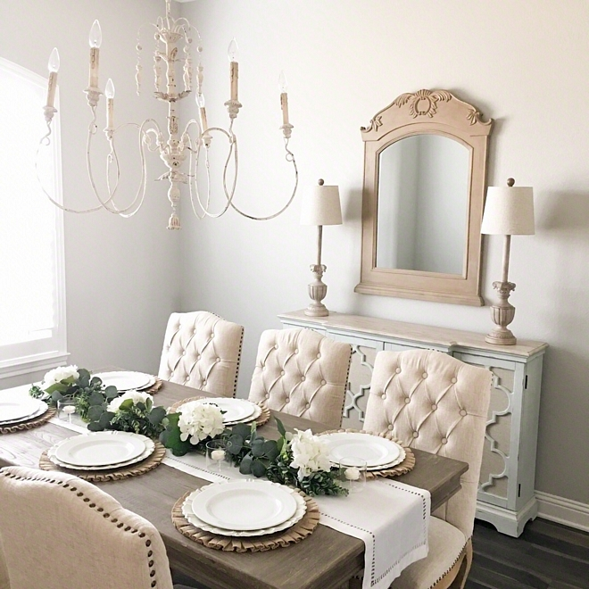 French Country Farmhouse Dining Room with White French Chandelier and neutral furnishings White French chandelier