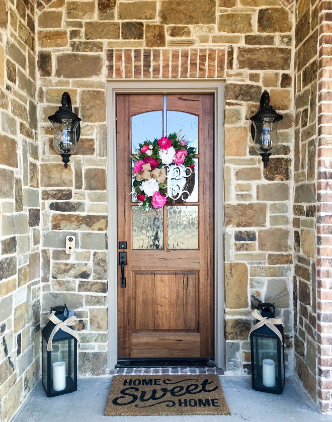 Stone exterior with wood door Stone exterior wood front door ideas Farmhouse exterior ideas