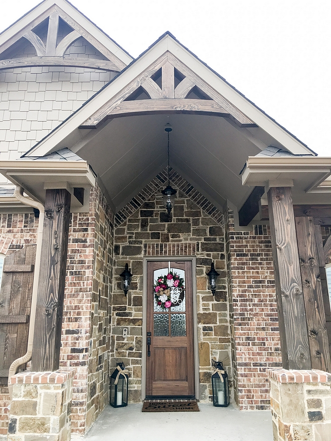 Brick and stone exterior with Timber wood columns and Timber Trusses front entry porch