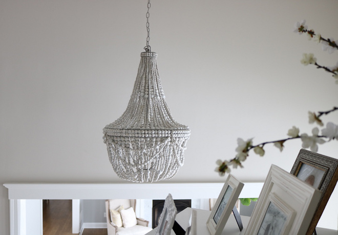 Grey Beaded Chandelier Whitewashed wood beads give the Francesca Chandelier a fresh, summery look Whether in a dining room or a seating area, it's a natural complement to any decor style #chandelier #beadedchandelier #graywash