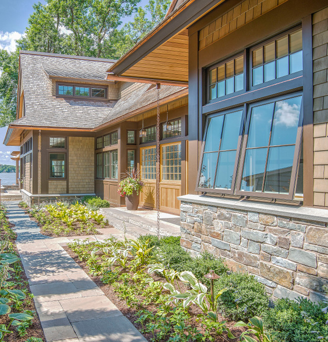Exterior Home Stone at base and terrace Glacier Stone (quarry) full depth veneer 'Loon Lake' granite Random Ashlar