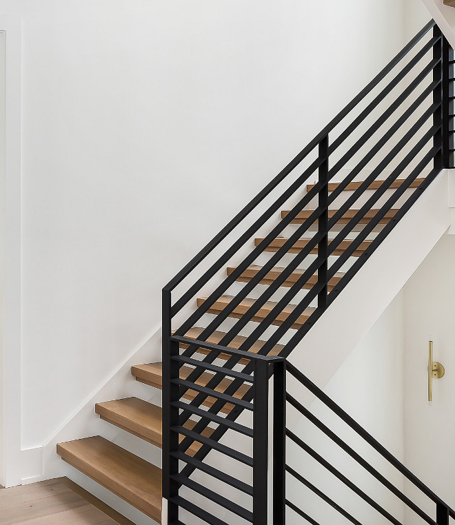 Metal Railing Staircase Metal Railing The staircase features White Oak treads and a custom black steel railing