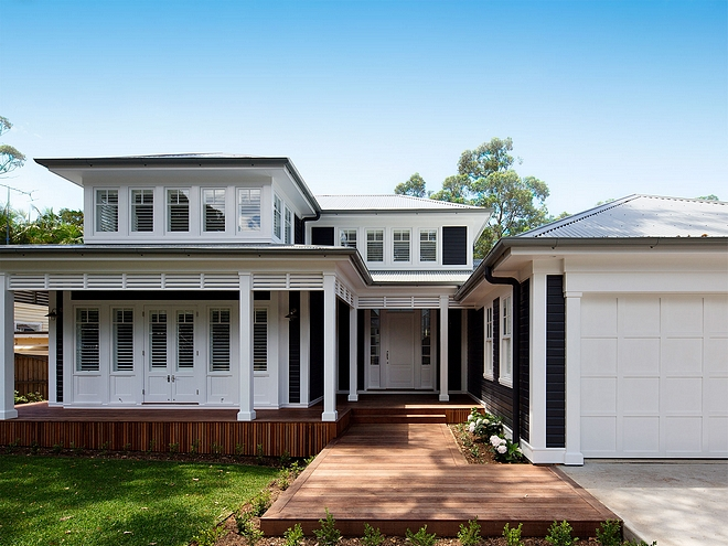 Black siding with white trim House paint color Dulux Domino