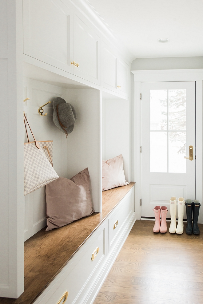 White mudroom lockers with wood stained bench and hardwood floors White mudroom lockers with wood stained bench and hardwood floor #Whitemudroom #mudroomlockers #mudroom #lockers #whitelockers #mudroombench