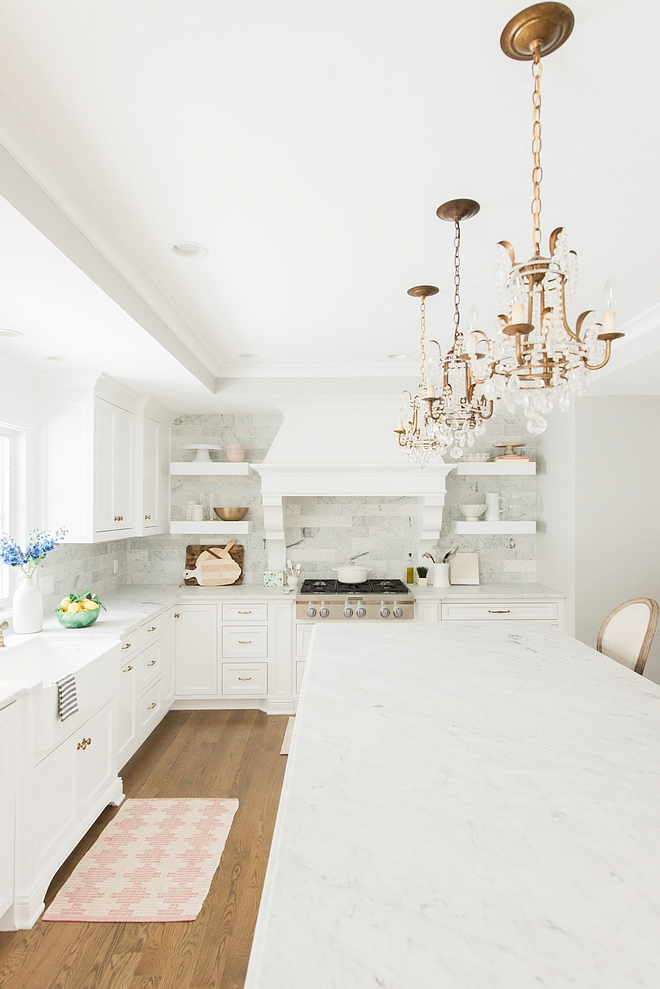 Kitchen remodel I fell in love with blogger Rachel Parcell's kitchen - the oversized range hood and open shelving with a marble backsplash that ran to the ceiling. I loved every detail so I worked with my builder to incorporate as many elements of that inspiration as possible into our space #kitchenremodel