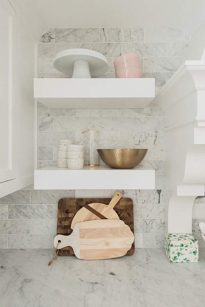 chunky white floating shelves Kitchen chunky white floating shelves Kitchen features chunky white floating shelves over white marble backsplash chunky white floating shelves #chunkywhitefloatingshelves #chunkyfloatingshelves #floatingshelves
