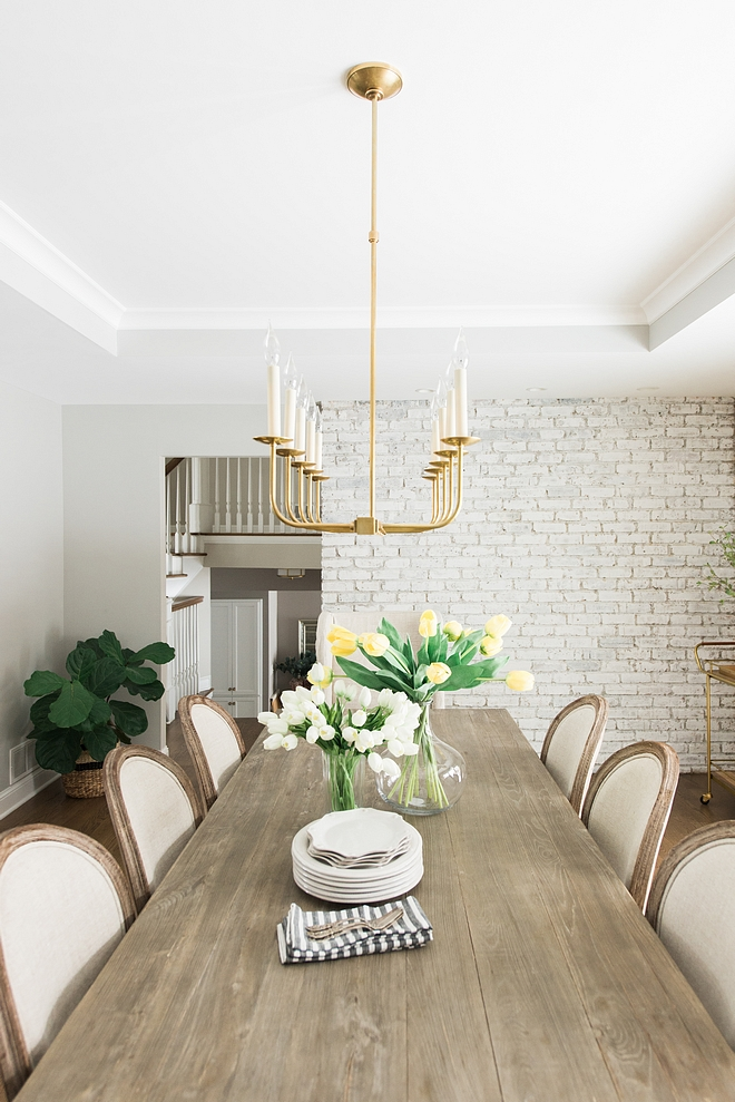 Modern Farmhouse Dining Table I love the natural, rustic feel of our dining table Modern Farmhouse Dining Table dining room with painted brick wall #ModernFarmhouse #DiningTable #paintedbrickwall