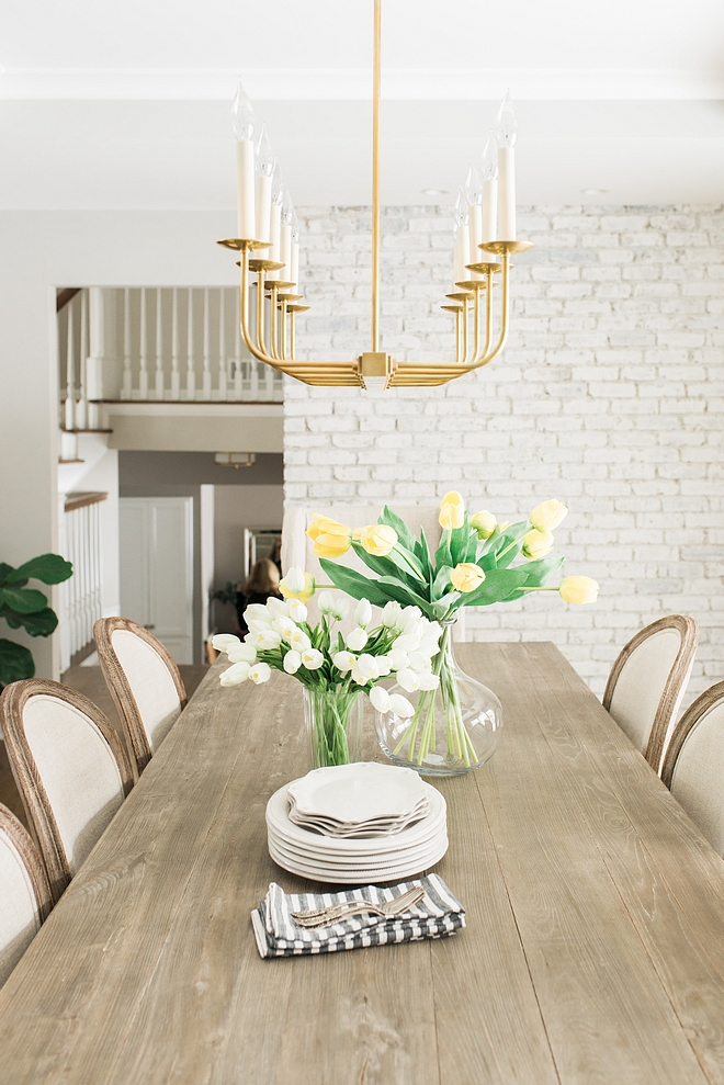 Dininr room The dining room features a painted brick accent wall #diningroom #brickaccentwall