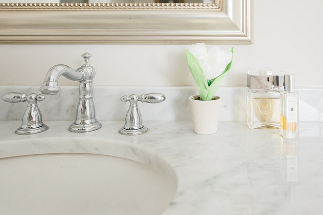 Timeless bathroom classic white marble countertop undermount sink and chrome bathroom faucet sources on Home Bunch