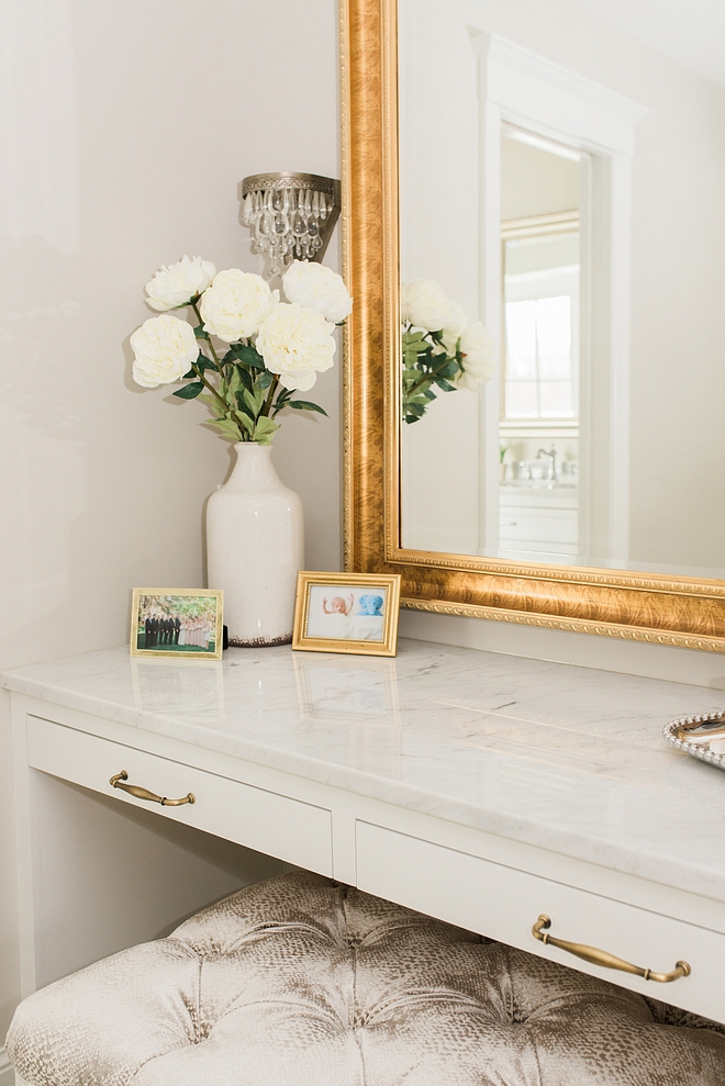 Vanity countertop is polished Carrara marble