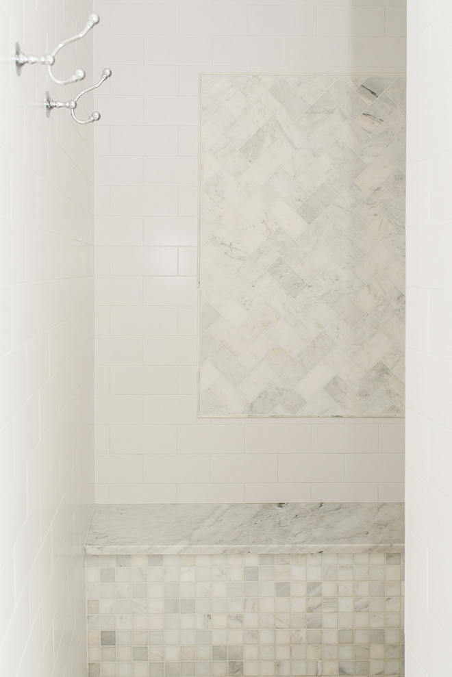 Classic shower combination shower with white subway tile and carrara marble subway tile accent wall marble shower bench #shower #tilecombination #showertile #marbleshower #subwaytileshower #showerbench