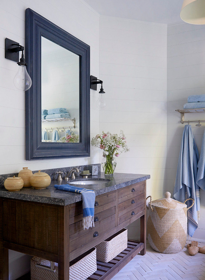 Reclaimed Wood Bathroom Vanity Bathroom features a vanity made of reclaimed wood with granite countertop, Riverrock Granite, shiplap wall paneling and herringbone floor tile
