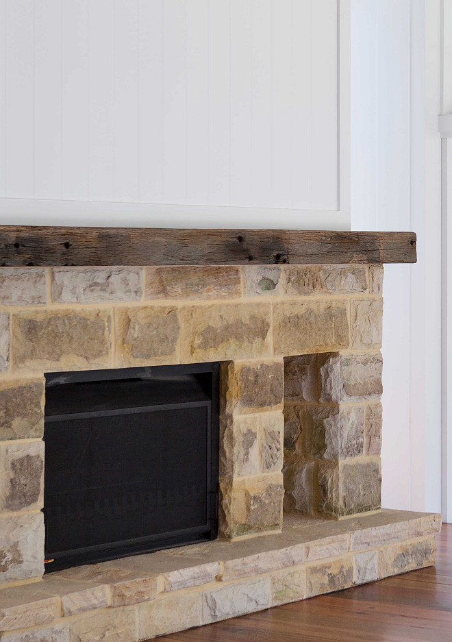 Stone Fireplace with Reclaimed Beam Large reclaimed sandstone blocks were used on the fireplace. These were salvaged from the previous home that was demolished A large recycled timber piece was used for the mantel #reclaimedbeam #fireplace #stonefireplace #reclaimedstone