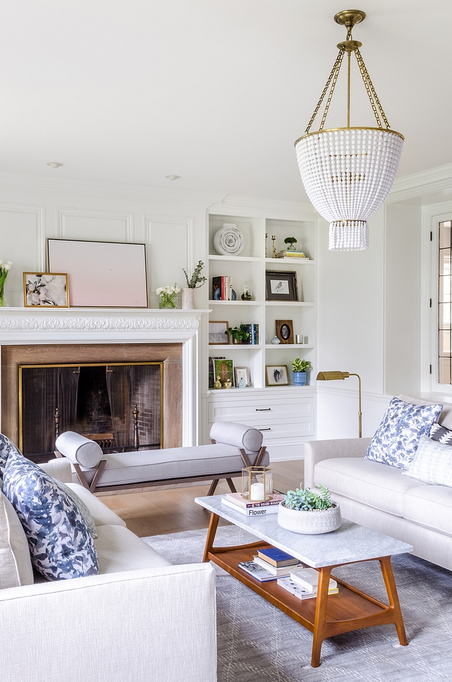 The Formal Living Room is my favorite as it effortlessly blends traditional, transitional, and mid century modern pieces into one cohesive room. The coffee table is from West Elm The showstopper in the room is the Visual Comfort Jacqueline beaded chandelier by Aerin Lauder