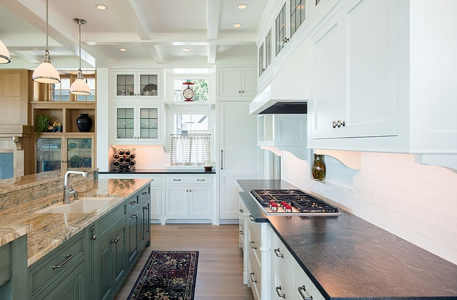 Kitchen Ovens and freezer drawers were placed in the pantry freeing up space for storage under the cooktop and reducing the need for confining kitchen walls The variety of cabinet/counter finishes and asymmetrical lines contributes to a friendly informality