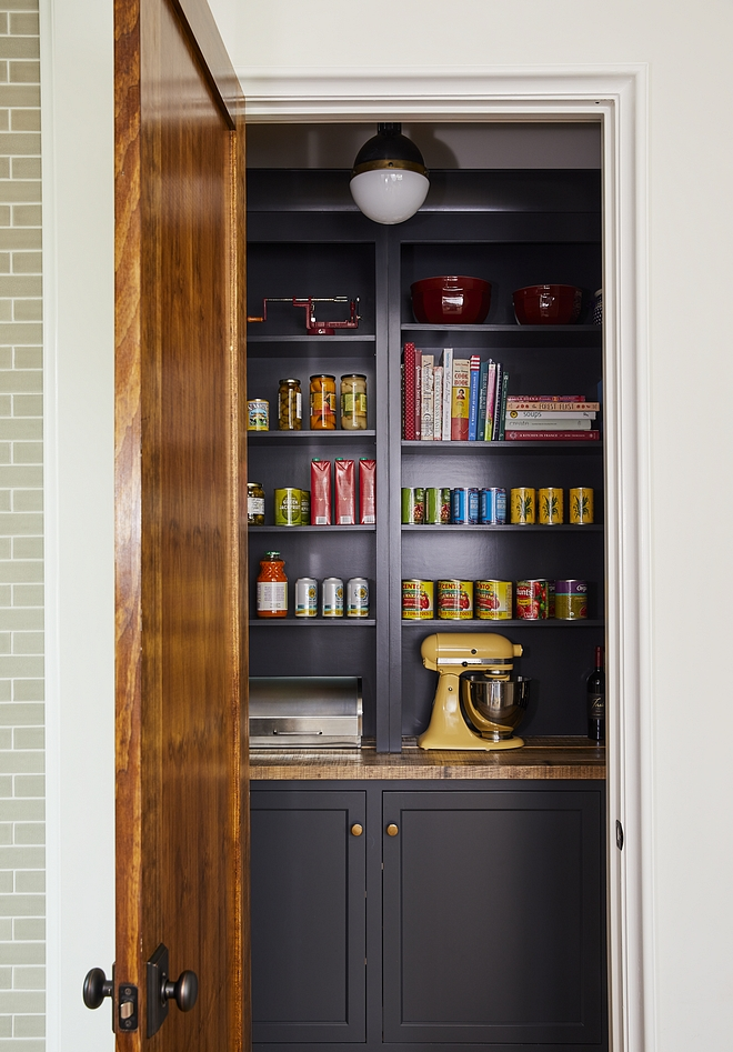Pantry Walk in pantry with navy blue back cabinets and open shelves painted in a Benjamin Moore paint color sources on Home Bunch #pantry #walkinpantry #BenjaminMoore #paintcolor