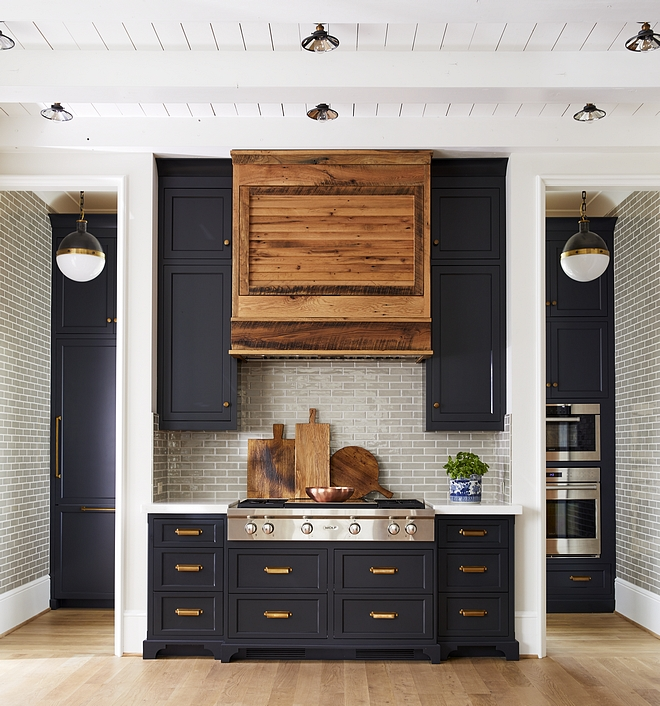 Kitchen Range Wall with Pantry Scullery on the back The fridge and the double ovens are just behind the main kitchen in the scullery You can see the paneled fridge to the left of the rangetop under the pendant and the ovens to the right #kitchen #rangewall #pantry