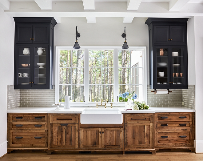 Two toned kitchen with reclaimed cabinets and blue black upper cabinets and grey crackle tile #twotonekitchen #reclaimedcabinet #reclaimedkitchencabinet #blackuppercabinet #crackletile