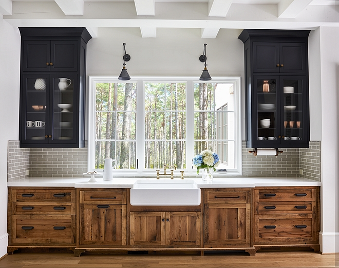 Kitchen Wood cabinetry is reclaimed white oak with a clear, matte sealant Upper cabinets are painted in Midnight Oil by Benjamin Moore