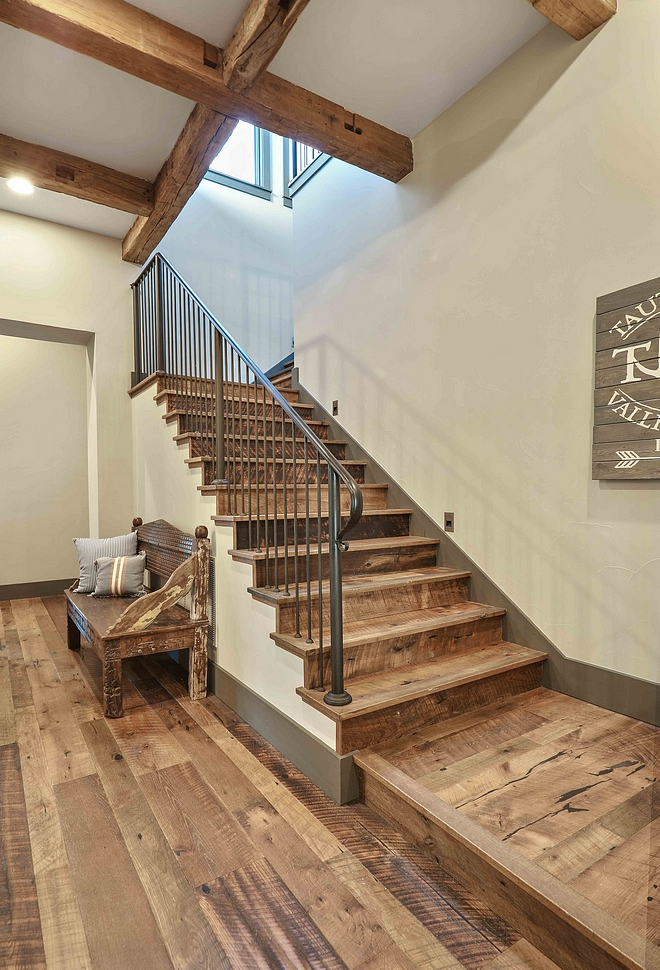 Reclaimed wood staircase with custom iron railing Reclaimed mixed hardwood flooring on a staircase #reclaimedwoodstaircase