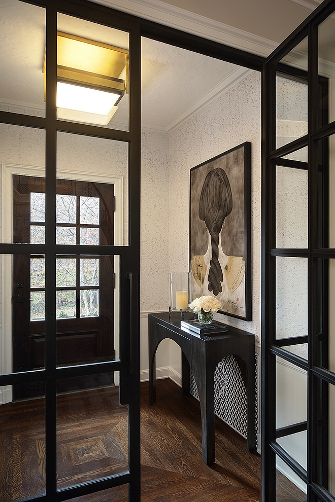 Foyer Black Steel Doors Custom black steel doors enclosures the foyer and brings a modern feel to this traditional home #blacksteeldoors