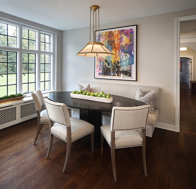 Breakfast Room This cozy breakfast room features a custom banquette and an oval dining table