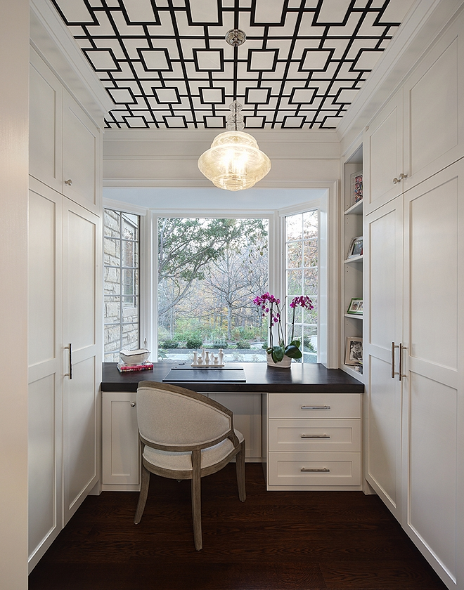 Pure White by Benjamin Moore Small home office with floor to ceiling built in cabinets and custom desk by window Paint color Pure White by Benjamin Moore #PureWhitebyBenjaminMoore #paintcolor #homeoffice