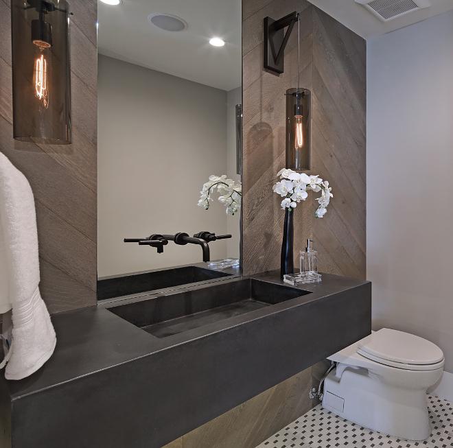 Chevron Shiplap Bathroom features custom cement sink and chevron shiplap walls