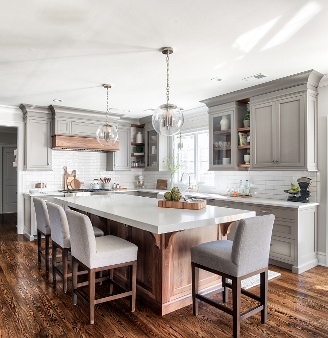 Grey Kitchen Beautiful grey kitchen with enlonged subway tile backsplash grey linen Counterstools clear glass globe lighting and Black Walnut kitchen island and Black Walnut hardwood floor #kitchen #greykitchen