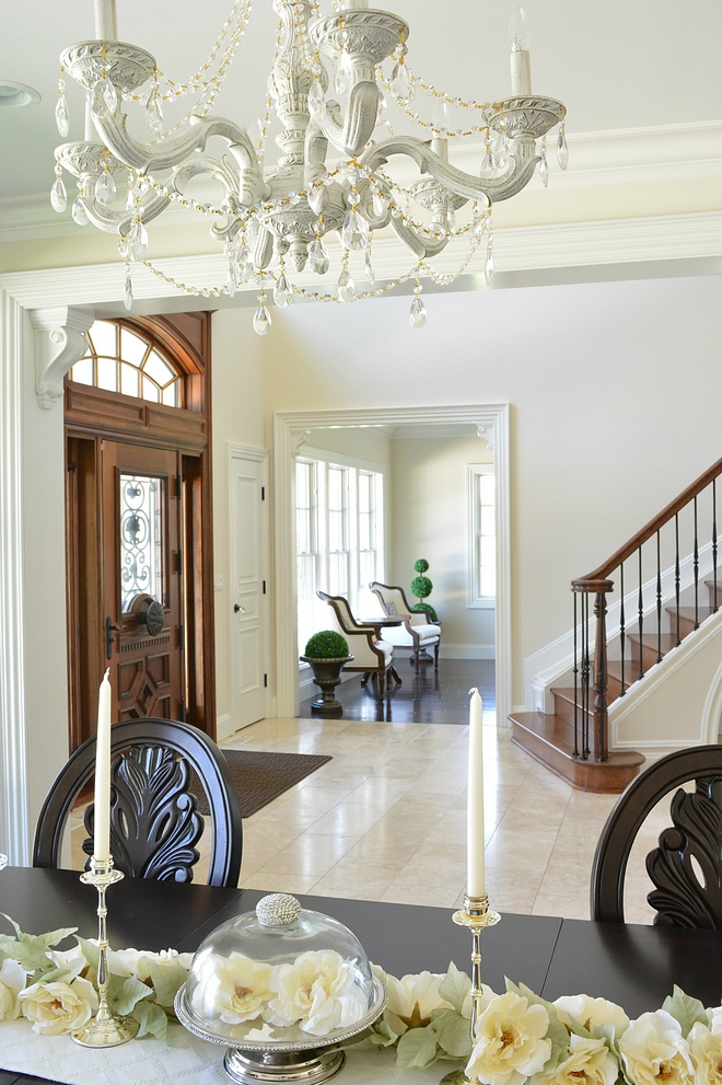 Traditional Foyer opens to Dining Room with painted chandelier #traditionalhomes #traditionalinteriors