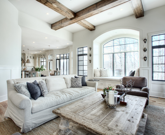 Farmhouse Living Room The beams in this farmhouse living room were out of alder and built-on-site by the builder finishers #farmhouse #livingroom #farmhouselivingroom #ceiling #beams #decor