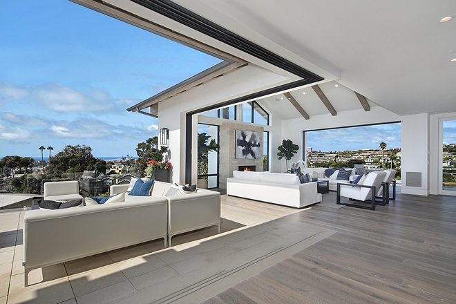 Living room Retractable patio doors open to the ocean view from the front deck with firepit and rear balcony
