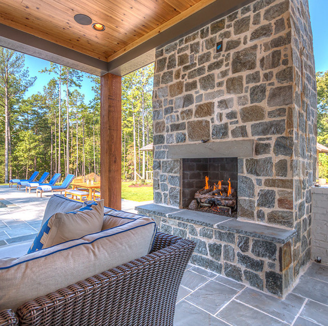 The back porch features an outdoor fireplace with grey natural stone